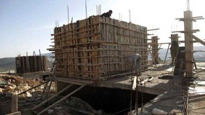 Palestinian-Workers-construct-new-houses-via-AFP.jpg